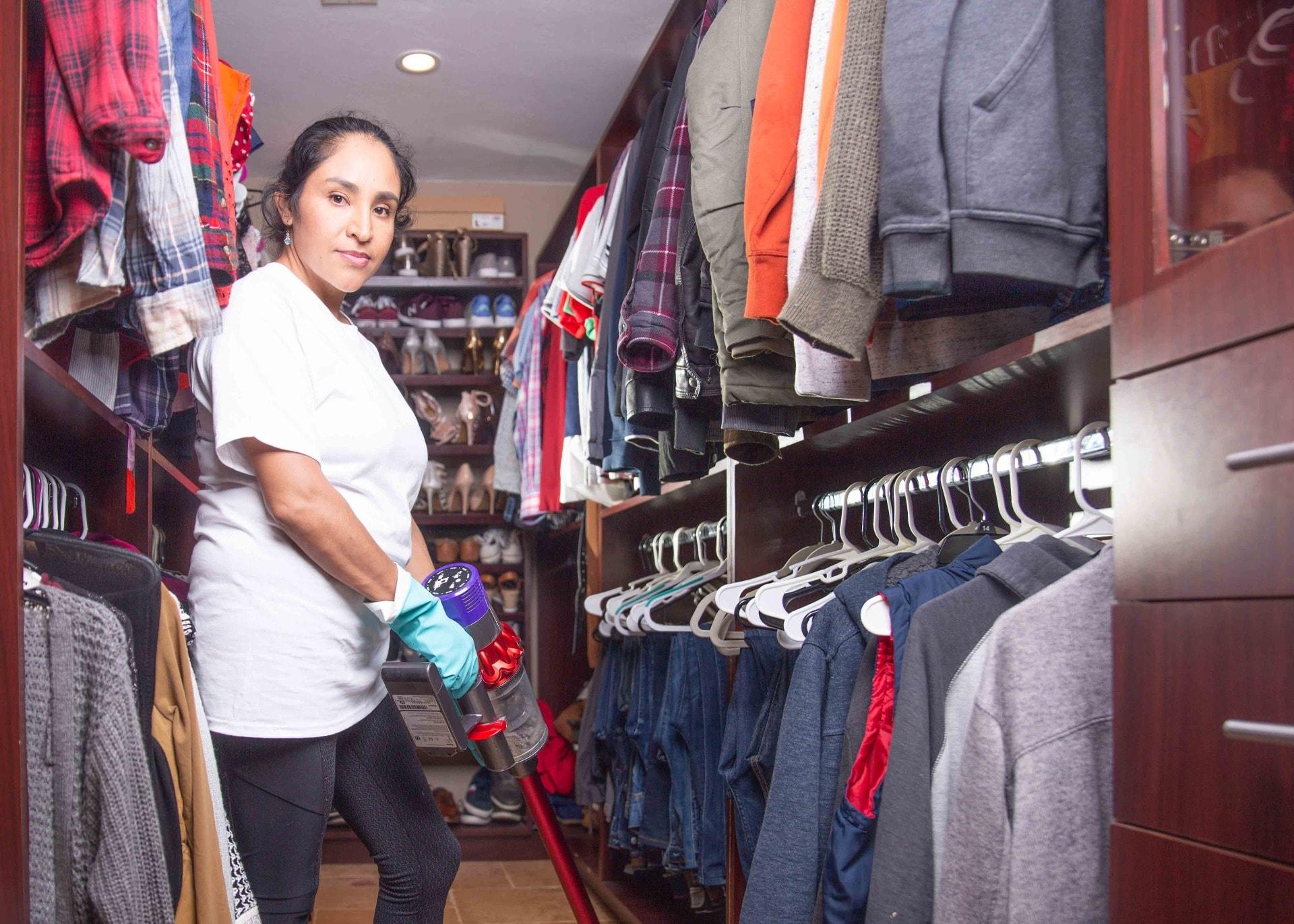 women vacuuming closet