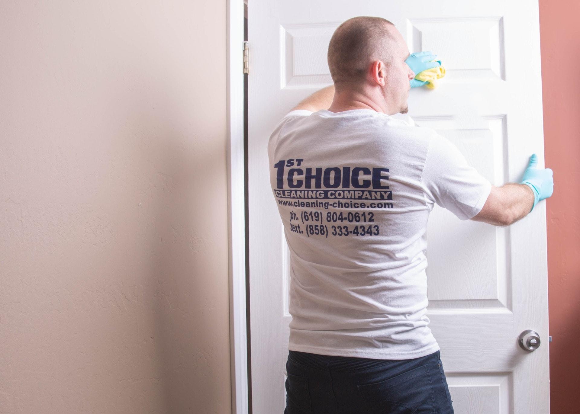 man mopping door