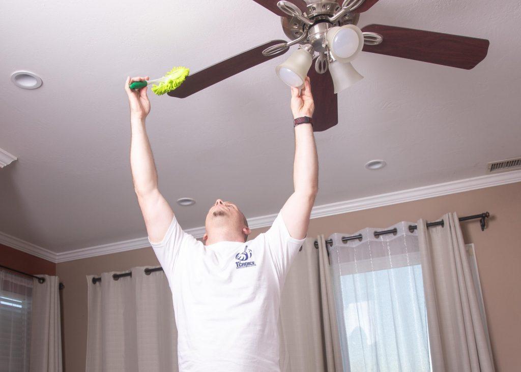 man dusting fan
